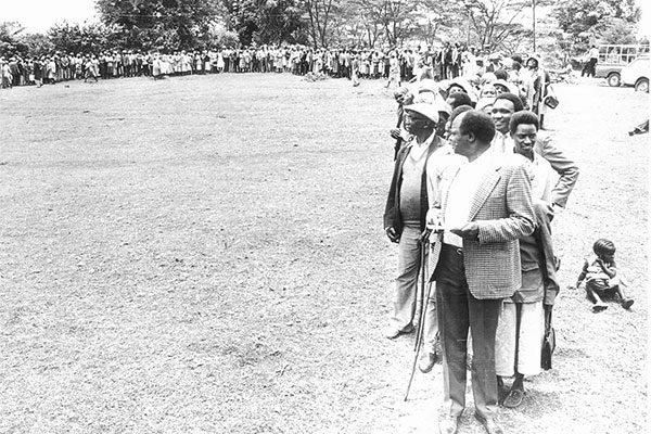 The Mlolongo election system in 1988. People just lined up behind their preferred candidates. This photo taken in Othaya shows Mwai Kibaki checking out his vote numbers.