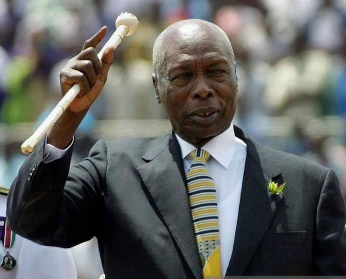 Retired President Daniel Moi raises his baton during a past holiday celebration. His was challenged by Amos Kandie for the Baringo Central parliamentary seat in 1997.