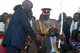Daniel Moi hands over the instruments of power to Mwai Kibaki in 2002.