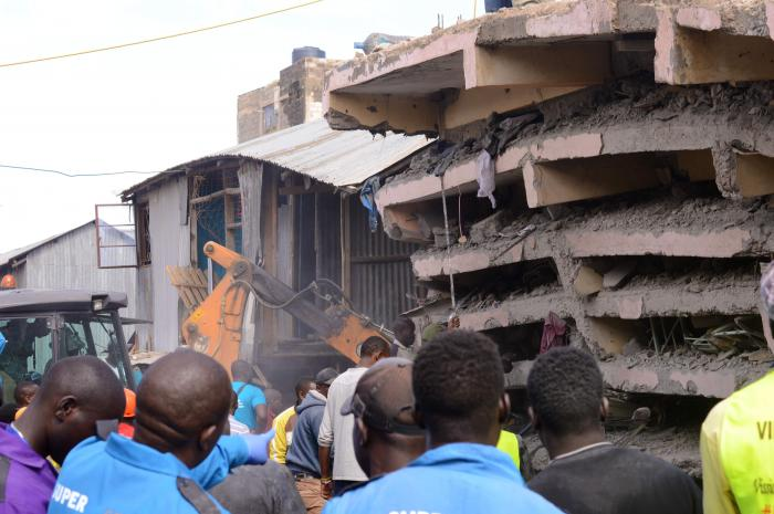 Residents mill around the scene where a building collapsed at Tassia on Decemer 6