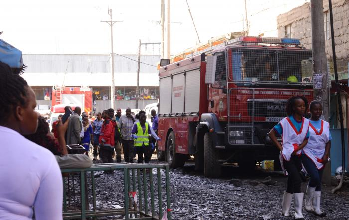 Rescue personel arrive at the scene of collapse of the building at Tassia on December 6