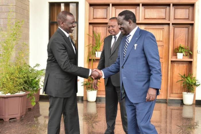 President Uhuru watches as Ruto and Raila shake hands