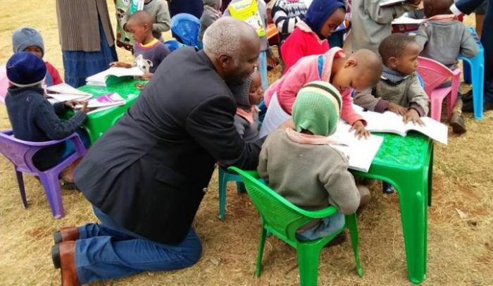 Makuenio Governor Kivutha Kibwana during the distribution of textbooks to ECD centres across Makueni county in 2018.
