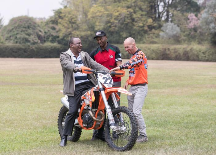 President Uhuru Kenyatta on a motorbike at State House on August 23, 2019.