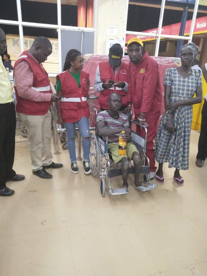 Members of Sonko Rescue Team visited Gilbert Otyeng and gifted him a wheelchair
