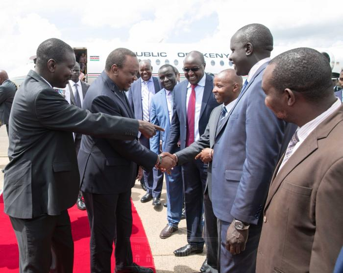 Uasin Gichu Governor Jackson Mandago receives President Uhuru Kenyatta.  He presided over the pass out ceremony of KDF recruits at Moi Barracks in Eldoret, September 11, 2019.