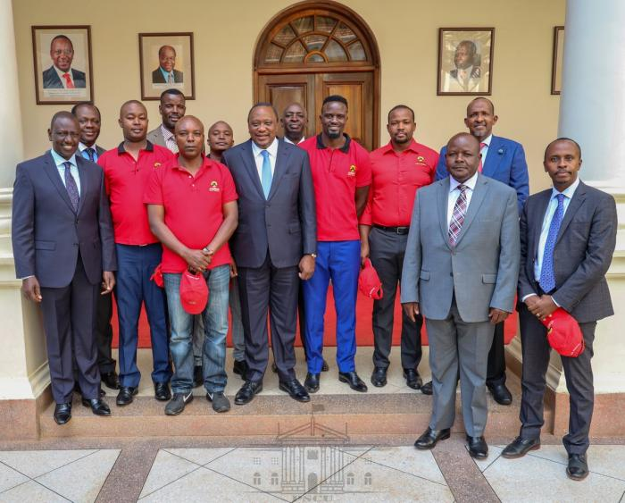 President Uhuru Kenyatta (left) goofs around with McDonald Mariga at State House while endorsing him for Kibra Parliamentary seat. Maina Kamanda declared his support for Imran Okoth, ODM's candidate
