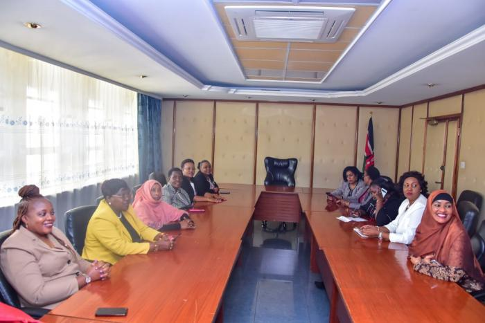 Passaris and other female legislators at the Ministry of Education in protest over the teacher who led to a student's suicide by shaming her over her periods.