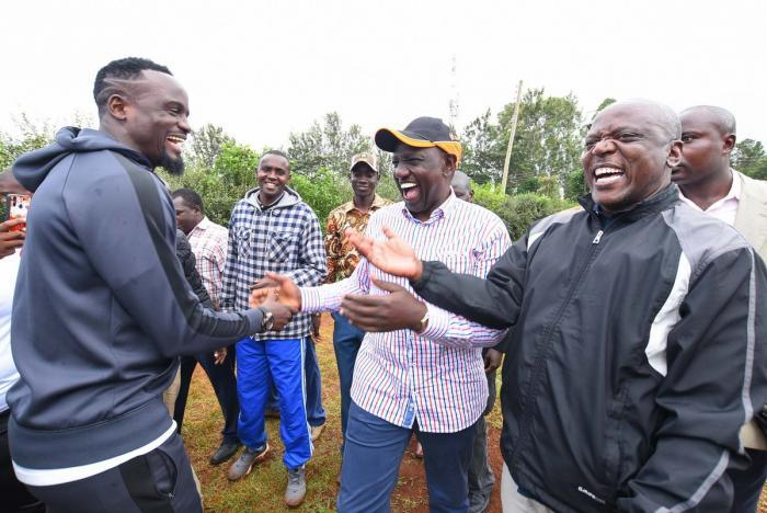 Former footballer Mcdonald Mariga (left) welcomes Deputy President William Ruto during the Mumboha Hustlers Cup in Luanda, Vihiga County on Monday, December 23, 2019.
