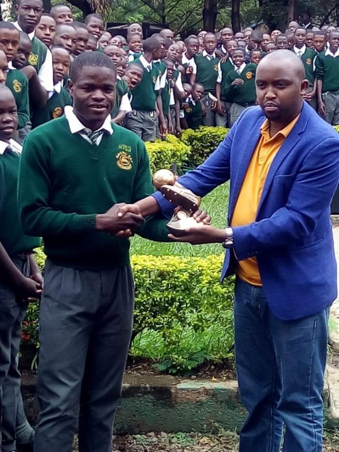 Western Stima FC striker Benson Omala receives his SJAK/LG Player of the Month award at Kisumu Day High School grounds on Wednesday, January 29