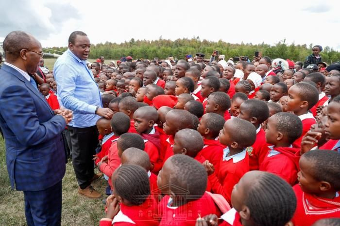 President Uhuru Kenyatta addresses pupils at Kenyatta Road Primary School in Nyandarua County on Friday, January 31,