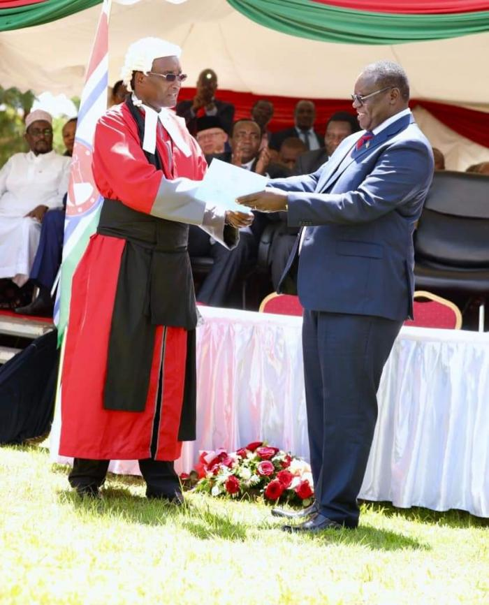 High Court Judge John Onyiengo(Left) and Kiambu governor James Nyoro during the latter's swearing-in ceremony at the county headquarters on Friday, January 31