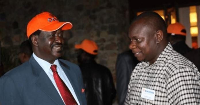 ODM Director of Communications Philip Etale (Right) with Raila Odinga. He has addressed allegations of receiving Ksh2 million bribe from Bernard 'Imran' Okoth.