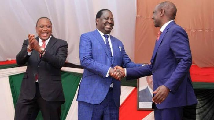 President Uhuru Kenyatta claps on as Raila Odinga and William Ruto shake hands. On November 18, panelist Herman Manyora urged the leaders to work together in securing the country's future.