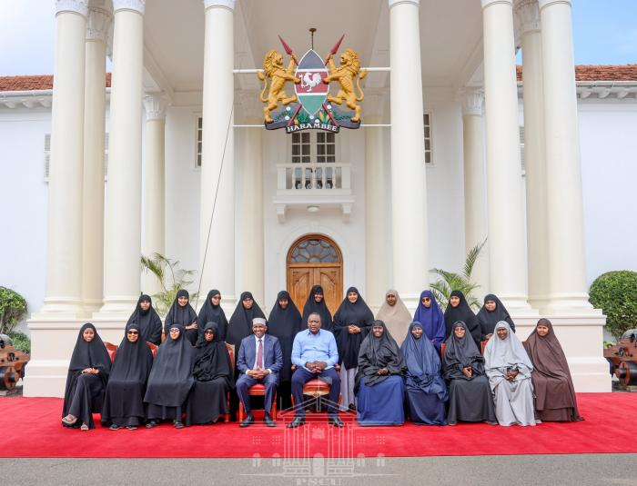 President Uhuru Kenyatta and Garissa Township MP Aden Duale pose for a photo with women delegates from the Hafsa Bint Siirin Centre in Garissa County outside the statehouse on November 20.