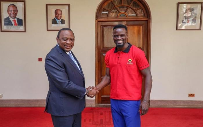 President Uhuru Kenyatta and McDonald Mariga. The Kibra parliamentary seat aspirant has come under harsh criticism from politicians and Kenyans alike regarding his eligibility and competence.