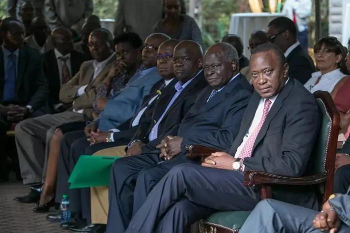 President Uhuru Kenyatta with retired President Mwai Kibaki who is seated next to his sons