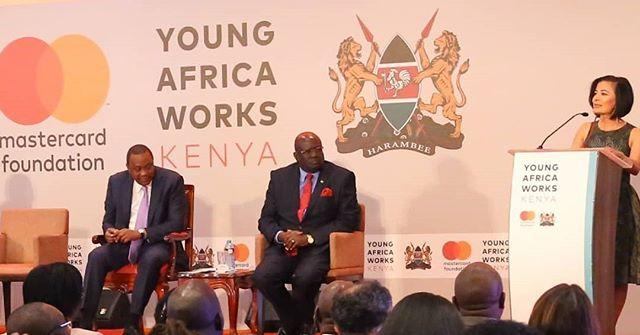 Gina Din at the Young Africa Works Kenya. Looking on is the Education CS George Magoha and President Uhuru Kenyatta.