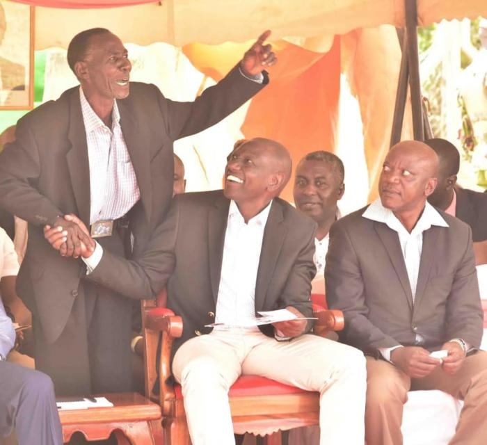 Image of DP William Ruto enjoying a hearty conversation with former schoolmate Sospeter Ojuwang August 23, 2019