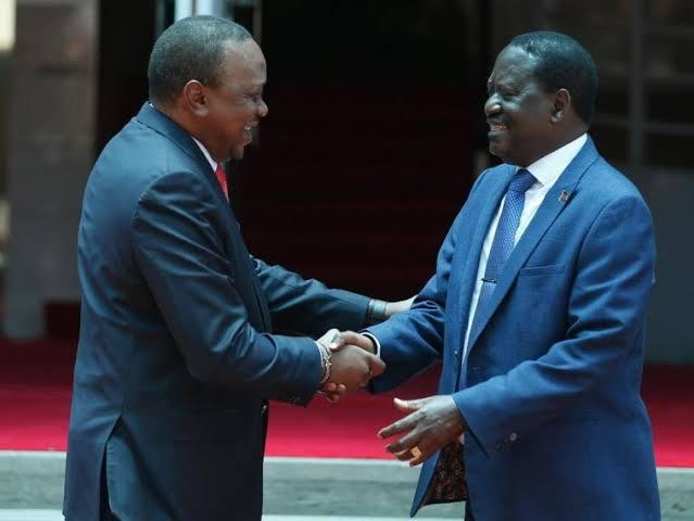 President Uhuru Kenyatta and ODM leader Raila Odinga shake hands outside the statehouse on March 9, 2018. The handshake brought an end to the chaos that followed the 2017 general elections.