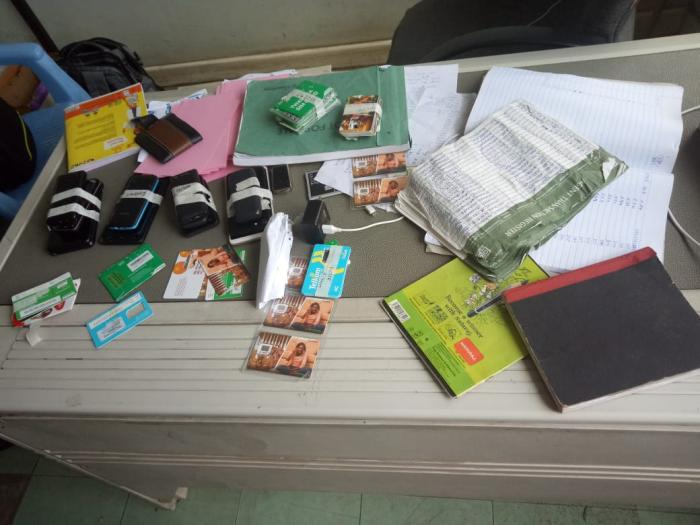 SIM cards and MPESA registration books found at the suspects' house in Kabete, Kiambu County. Photo: Twitter
