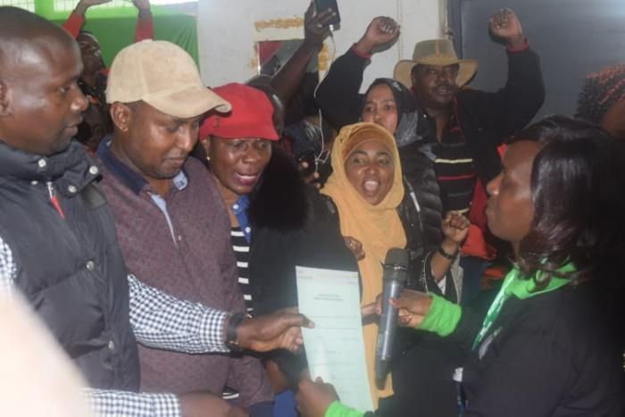 ODM's Imran Okoth recieving his IEBC victory certificate on Friday, November 8.