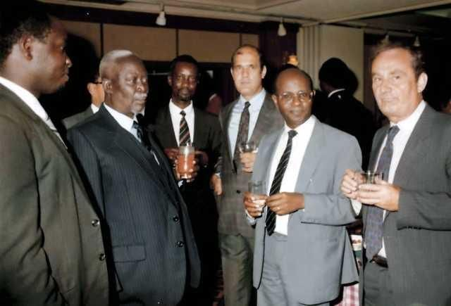 Jaramogi Odinga (second left) and Mr George Wachira (right) during a business partners cocktail party at the Stanley Hotel, Nairobi in 1986.