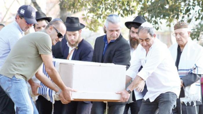 Jewish priests carry Tob Cohen's casket. His brother narrated how the deceased took good care of his wife.