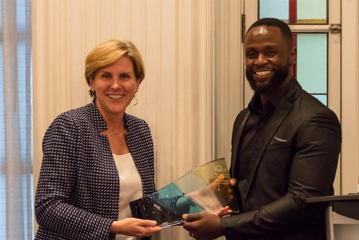 Trace International CEO Alexandra Wrage presenting an award to Africa Uncensored's investigative journalist John Allan Namu (right) in Vancouver, Canada on June 26, 2019.