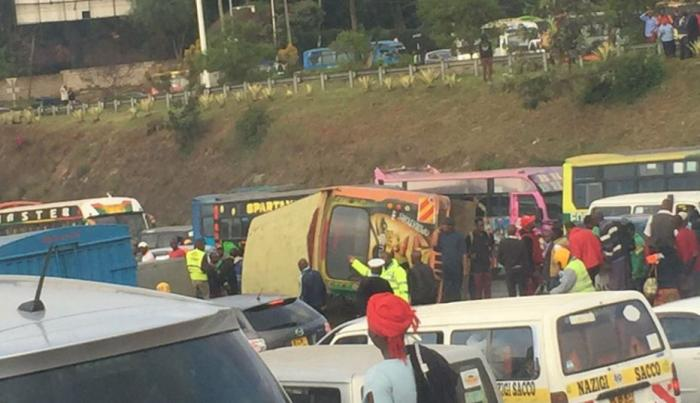 A bus also overturned along the highway