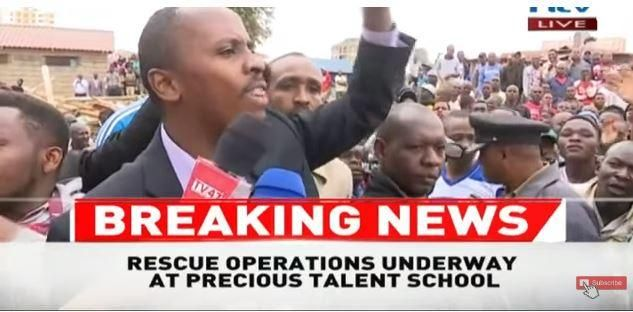 Dagoretti Member of Parliament John Kiarie addressing jeering residents in the scene of the collapsed story.