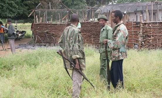Kenya Police Reservists at Pandanguo village count losses after an attack by militants in the village in this July 11, 2014.
