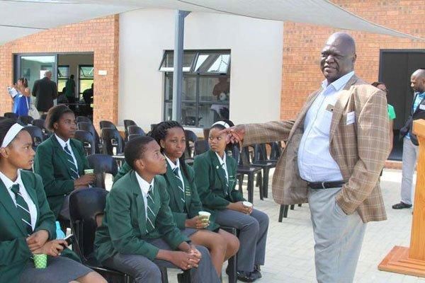Founder Nova Academies Mr Christopher Khaemba with Pioneer Academy Jackal Creek campus students in Johannesburg in South African on December 10, 2016.
