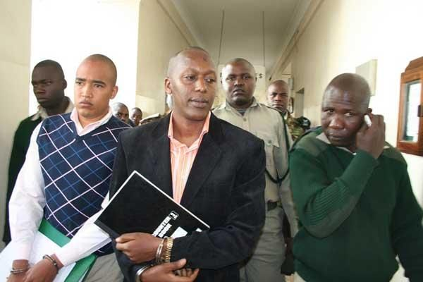 Alexander Chepkonga (left), and Dickson Munene in Nairobi Court September 2014 where they were charged with the murder of Dr James Ng'ang'a Muiruri in Westlands