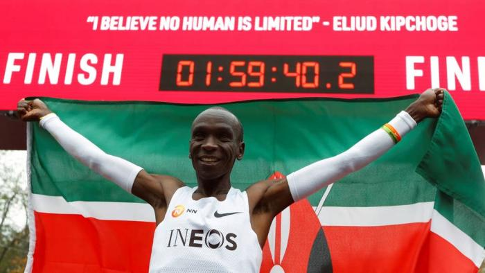 Eliud Kipchoge celebrates after winning the INEOS 1:59 Challenge in Vienna, Austria on October 13, 2019.