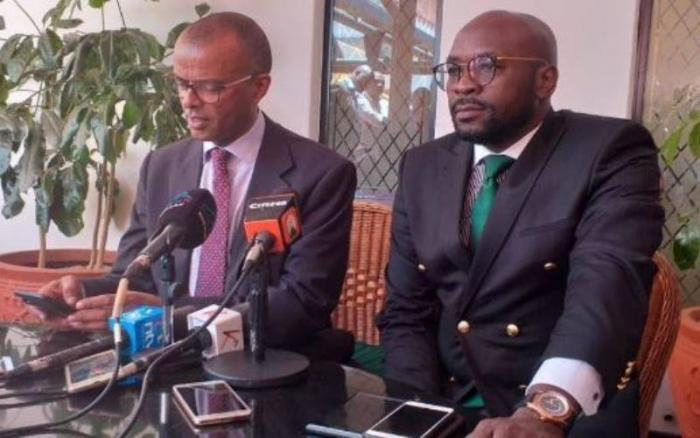 Lawyers Philip Murgor and Cliff Ombeta addressing reporters in Nairobi. Murgor was placed on the spot during Wairimu's plea-taking hearing.