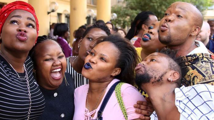 Members of LGBTQ community take a selfie at the High Court on February 22, 2019, during landmark ruling on the decriminalisation of same-sex in Kenya