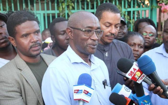 Pathologist Petr Ndegwa speaking to the media during a past incident. He disclosed that the defense team did not want him to preside over Cohen's post mortem.