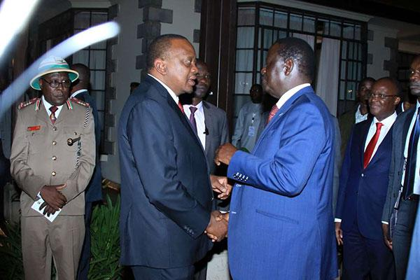President Uhuru Kenyatta (left) talks with Opposition leader Raila Odinga during the closing session of the AfroChampions Boma forum at Windsor Hotel on April 17, 2019. The two are expected to launch BBI at Bomas of Kenya on Wednesday, November 27, 2019