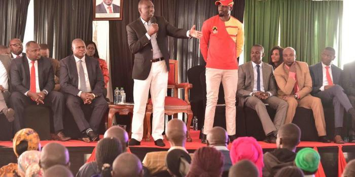 DP William Ruto with McDonald Mariga at his Karen office on Tuesday, October 8. Ruto promised to transform Kibra