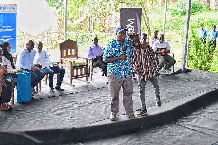 Interior CS Fred Matiang'i with Mombasa based rapper Ohms Law Montana in Mombasa on January 13, 2020.