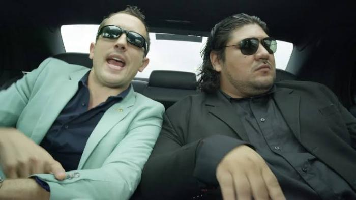 Jason Dunford (Left) with Romantico in a music video for their song 'Mbaya'