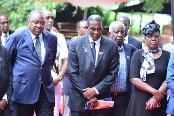 President Uhuru Kenyatta (l) and Alice Wahome (r), pay their last respects to former Cabinet Minister Charles Rubia on Monday, December 30, 2019, in Kandara, Murang'a County