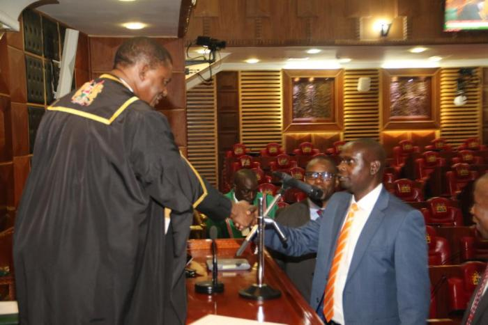 National Assembly Speaker Justin Muturi (l) congratulates Imran Okoth after swearing him to office, November 19, 2019.