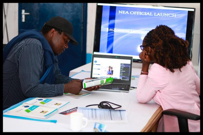 A National Employment Authority official attending to a client during the Nairobi Trade Fair