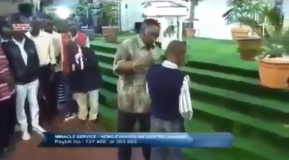 A screenshot of Pr. Ng'ang'a raining slaps on a boy in his church in a past Sunday service.