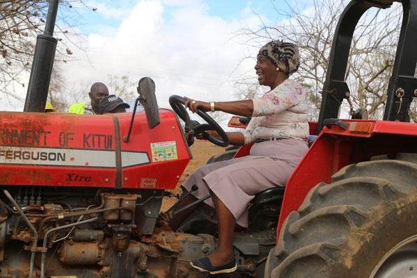 Gov Ngilu driving a tractor during the launch of a health and food project