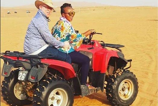 Nominated Senator Isaac Mwaura and his wife pictured riding a quad bike