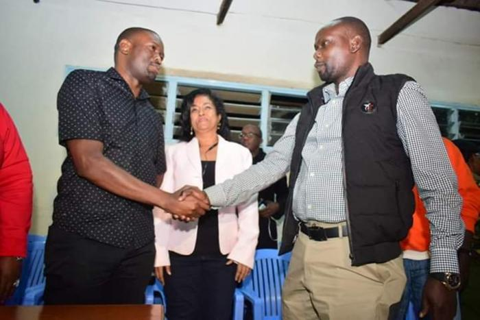ODM Party Secretary-General Edwin Sifuna shakes hands with Bernard 'Imran' Okoth. The party has welcomed any complaints against the Imran's win