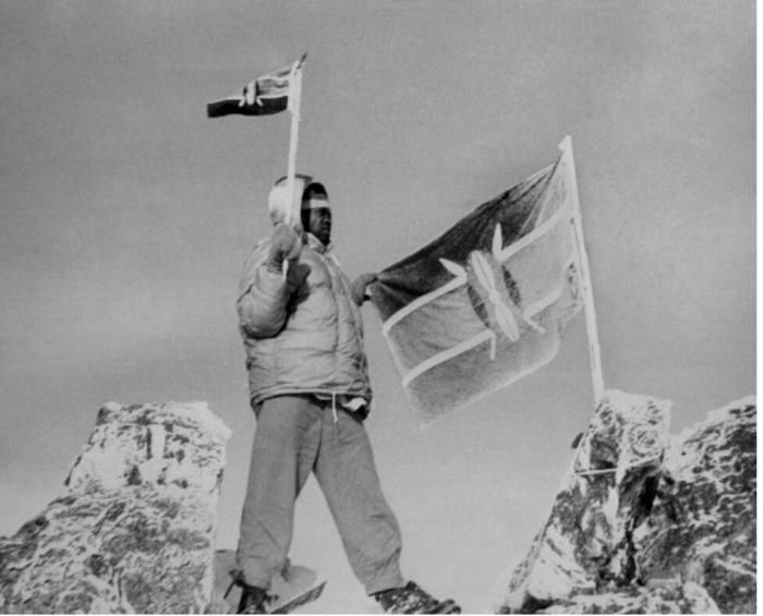 Kisoi Munyao hoists Kenya's flag on the highest peak of Mt. Kenya in 1963.
